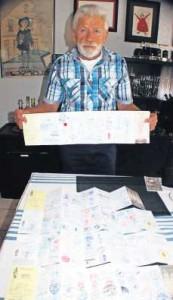Stolz zeigt Hans Reh seine Pilgerpässe mit den Stempeln.
